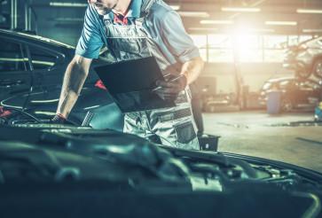 Professional Automotive Mechanic Making Documentation