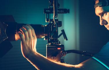 Professional Camera Operator with Pro Digital Equipment Taking Video Shots