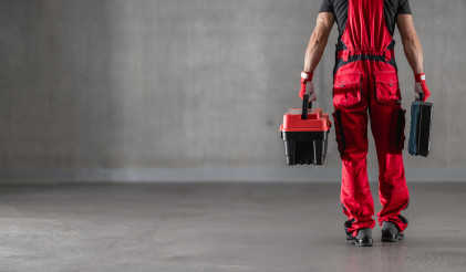 Professional Caucasian Worker with Toolboxes in His Hands