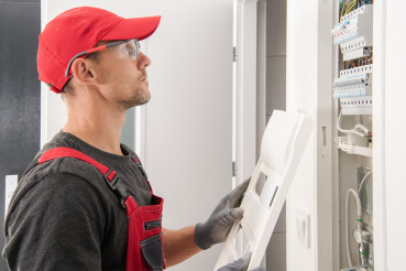 Professional Electrician Checking Fuse Boxes
