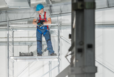 Professional HVAC Technician Worker on Scaffolding