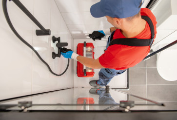 Professional Plumber Finishing Shower Head Installation