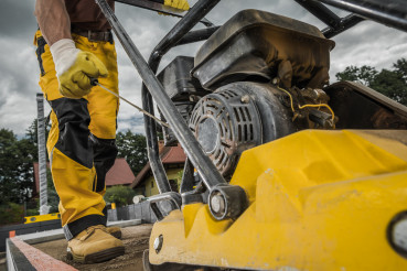 Professional Soil Compactor Operated by Construction Worker