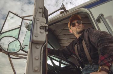 Professional Trucker Driver in Semi Truck Cabin