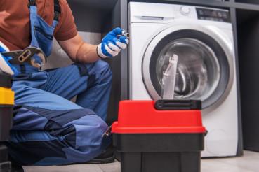 Professional Worker Installing Washing Machine