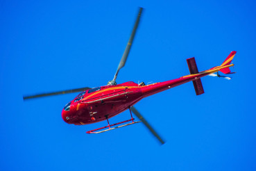 Red Helicopter on the Sky