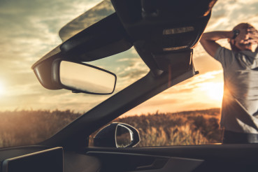 Relaxed Man Enjoying Summer Sunset While on Road Trip in Convertible Car