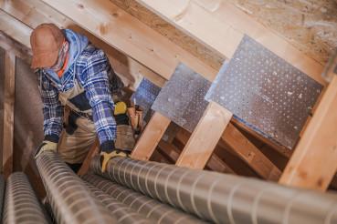 HVAC Technician Assembling Air Vent In House.
