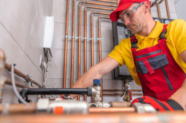 Residential Heating Systems Technician at Work