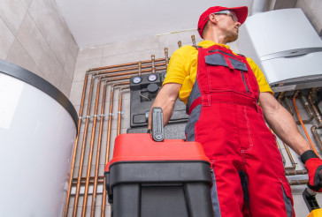 Residential HVAC Service Worker Performing System Check