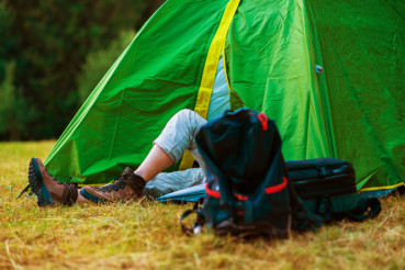 Resting Hiker in a Tent