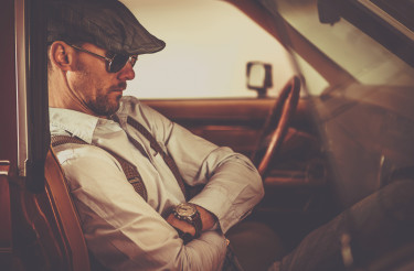 Retro Looking Men Seating Inside Classic Car