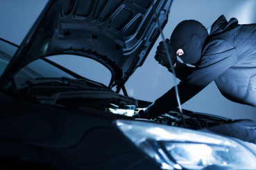 Robber Disabling Car Alarm