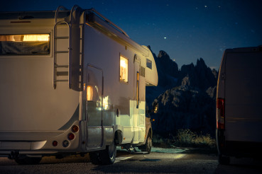 RV Camper Van Camping in the Middle of Mountains