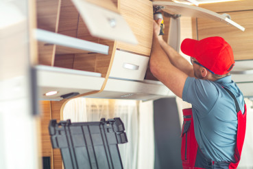 RV Recreational Vehicle Interior Finishing by Professional Worker
