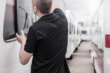 RV Travel Trailers Specialist Performing Windows Seals Check
