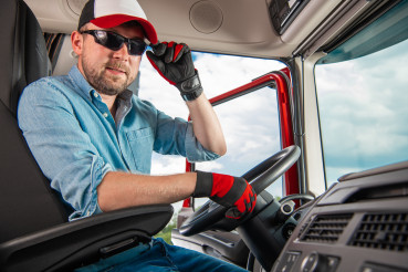Satisfied Caucasian Semi Truck Driver