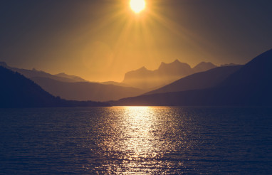 Scenic Northern Norway Sunset with Ocean Bay and Mountains Range
