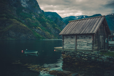 Scenic Norwegian Fjord Landscape with Rustic Cabin