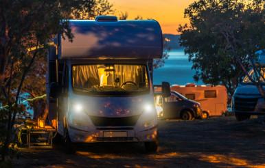 Scenic RV Park Campsite Sunset with Camper Vans