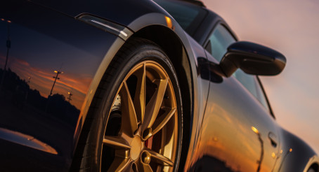 Scenic Sunset Reflection in Supercar Body