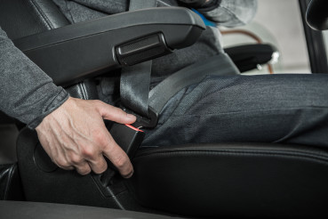 Seat Belt Fastening by Caucasian Bus Coach Driver