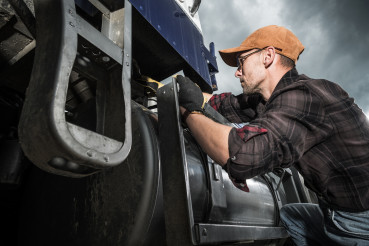 Semi Truck Driver Checking Vehicle Elements