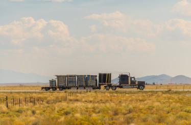 Semi Truck on a Highway Crossing Colorado Valley