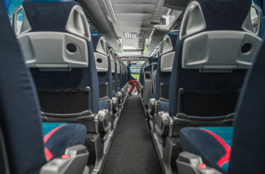 Shuttle Bus Driver Awaiting Passengers Inside the Vehicle During Virus Outbreak