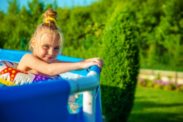 Smiling Girl in a Swimming Pool
