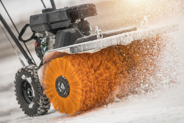 Snow Removal with Brush Broom in Action
