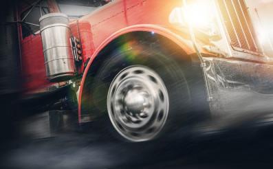 Speeding Powerful Semi Truck in Heavy Rain