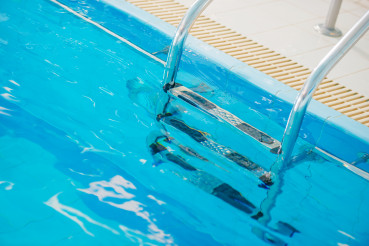 Swimming Pool And Stainless Steel Pool Ladder.
