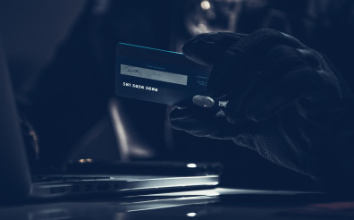 Stolen Credit Card in Thief's Hands Fraud Concept