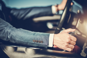 Successful Men Driving Car
