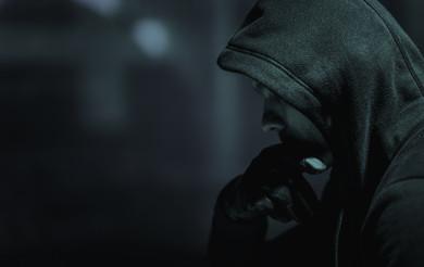 Suspicious Men in Black Hoodie