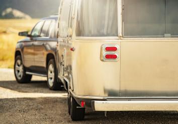 SUV with Retro Classic Travel Trailer Road Trip