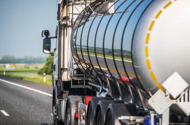 Tank Trailer Semi Truck on a Highway