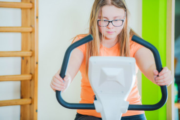 Teenage on Exercise Bike