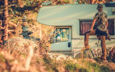 Tourist in Front of His Camper Van RV Motorhome
