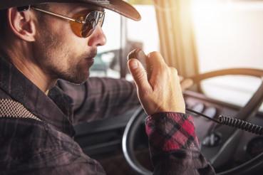 Semi Truck Driver Communicating On CB Radio.