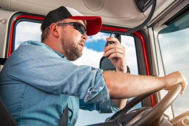 Truck Driver Taking Conversation Using CB Radio