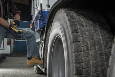 Trucker Preparing His Semi Truck For the Next Heavy Duty Delivery
