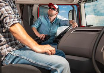 Two Caucasian Truckers International Haul Team