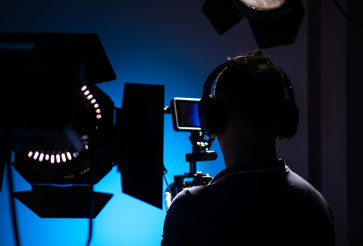 Video Production Studio Equipment and Camera Operator