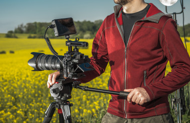 Videographer Operator with Professional Digital Camera