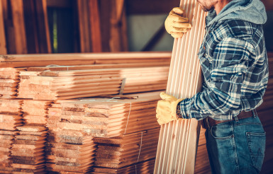 Stack Of Wooden Planks At Lumber Store.