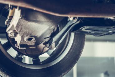 Car Raised On Lift In Auto Repair Shop.