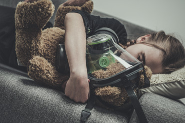 Sleeping Girl With Teddy Bear In Gas Mask.