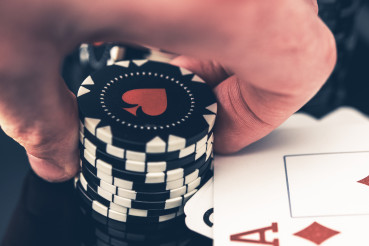 Stack Of Poker Chips And Winning Cards On Table.